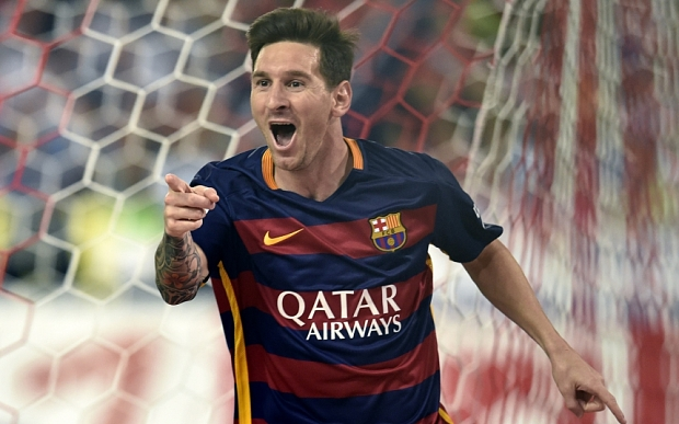 TOPSHOTS Barcelona's Argentinian forward Lionel Messi celebrates after scoring during the Spanish league football match Club Atletico de Madrid vs FC Barcelona at the Vicente Calderon stadium in Madrid on September 12, 2015. AFP PHOTO/ GERARD JULIENGERARD JULIEN/AFP/Getty Images