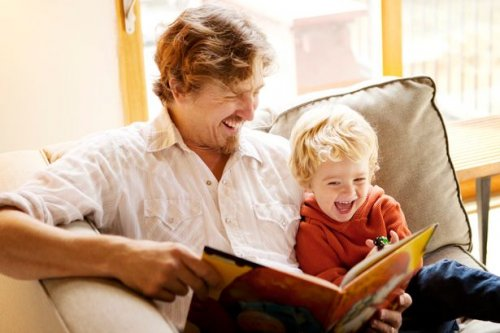 Father-and-son-reading-on-the-couch_500x333