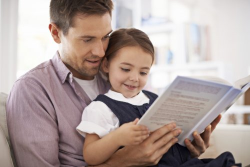 Father reading with daughter_500x334